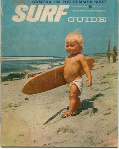 baby surfer - October 1964 cover of Surf Guide - more info on details of the photo and board and baby at link