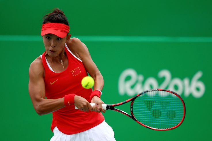 Qiang Wang of China plays a backhand against Swetlana Kuznetsova of Russia in their first round match on Day 2 of the Rio 2016 Olympic Games at the Olympic Tennis Centre on August 7, 2016 in Rio de Janeiro, Brazil.