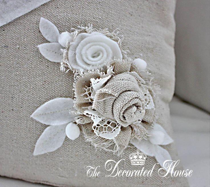 The Decorated House. Fabric Flowers.... These flowers are made from a thick unbleached cotton, with the edges frayed some, and old lace, with white felt flowers and leaves. The combination is subtle in color and textures.