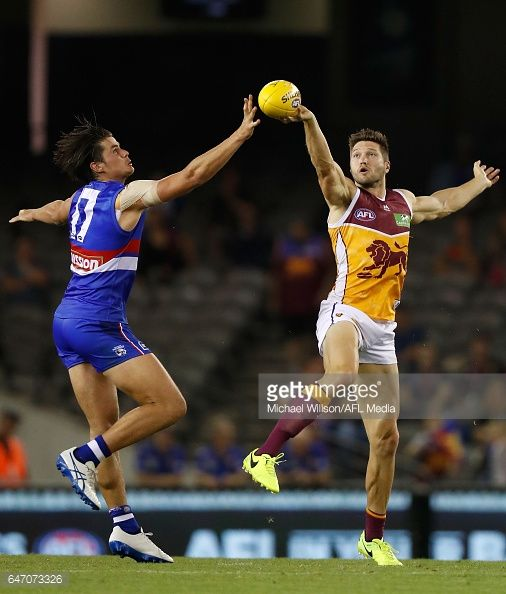 Stefan Martin of the Lions and Tom Boyd of the Bulldogs compete in a ruck contest during the AFL 2017 JLT Community Series match between the Western...