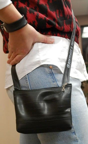I've had one of these for a couple of years..love it!!!!!!!! Hipster Purse Made from Bike Inner Tubes by ReVelo on Etsy, $24.00