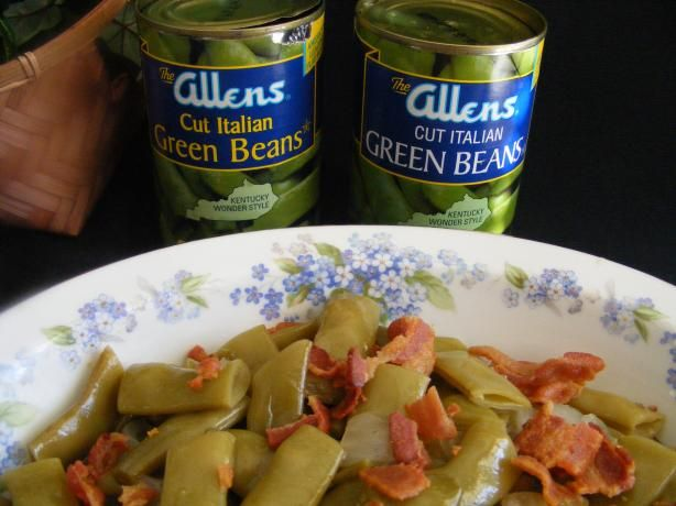 Italian Green Beans aka Kentucky Wonders... Dad grew these flat, flavorful green beans in our garden.  The pic shows which canned beans to buy... 2 (14.5 oz) Italian cut green beans, drained; 4 slices Bacon (save drippings); 4 cups Water; 1/2 Onion, diced; 1 Tbsp. Sugar; 1/2 tsp. Salt.   Fry bacon til crisp, crumble and set aside. Place drained beans and water in a medium-size saucepan; Cover. Add remaining ingredients. Simmer on Low for about 1 1/2 hours. Serve with crumbled bacon garnish.