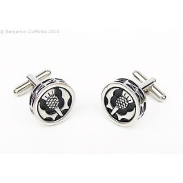 Raised Scottish Thistle Cufflinks - These beautiful pewter cufflinks are imported direct from Scotland. They are raised on the sides with a pattern of thistle leaves around the edges. The black enamel background gives this a crisp finish.