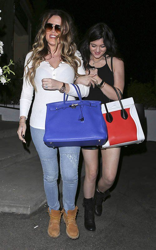 Khloe Kardashian wearing  Hermes Birkin Bag in Navy Blue Timberland boots  Shibuya sushi restaurant in Calabasas September 10 2013