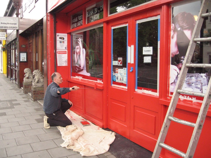 James adding a fresh lick of paint to the front of our store in readiness for the Olympic torch passing by #DIY #greenwich #olympictorch #independentretail #shopfront