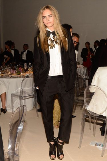 The New Rules in Party Style - 1) Tie One On: Take a cue from model darling Cara Delevingne and top your le smoking with a boyish bow tie. Layered with bold jewelry it's the newest trick in statement neckwear.