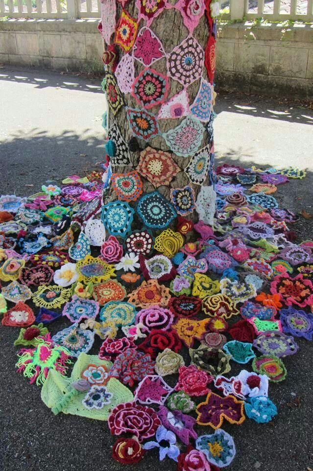 """In the fall, a group encased trees throughout the Ped Mall with sleeves of yarn, like this. Think of wrapping the quilt you have in your basement around a tree and letting it shrink to size as it wets and dries. This is not unique to Iowa City; in fact, """"yarn bombing,"""" as it is called, is growing to be a widespread feminist form of graffiti art: http://www.nytimes.com/2011/05/19/fashion/creating-graffiti-with-yarn.html"""