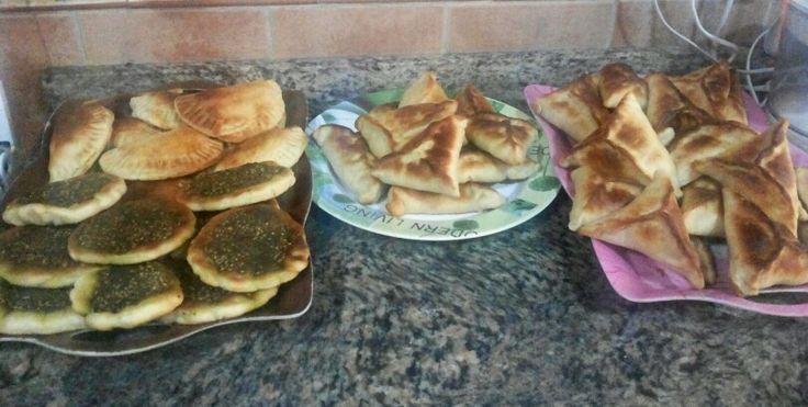 Mix baked savoury pies (fatayer) ... spinich pies, cheese pies, beef sambosa, and za'atar mana'esh.