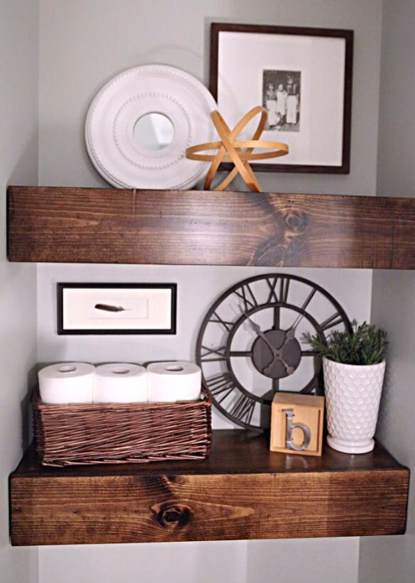 Chunky oak shelves behind toilet for decorative touches and guest towels.