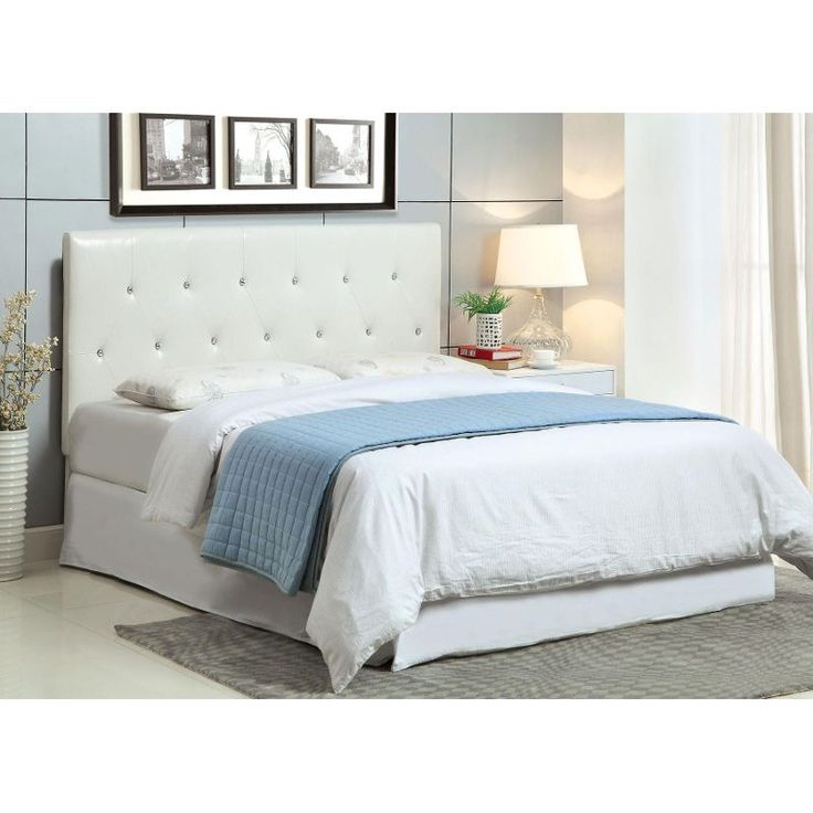 Crystal White Upholstered Headboard With Blue Blanket And Nightstand