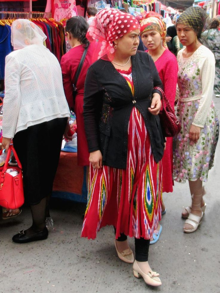 Colorfully dressed Uyghur women frequent the Grand Bazaar in Kashgar, Xinjiang, China.