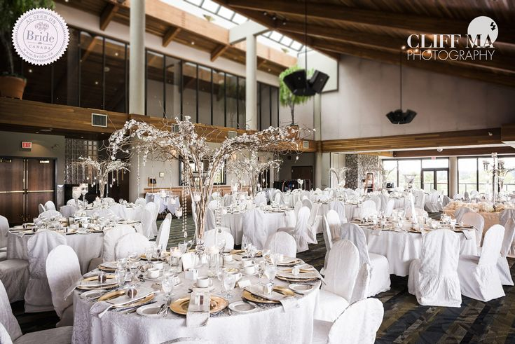 The high peaked ceiling at Northview Golf & Country Club in Surrey, BC, gives the reception room an open, airy feel. Photo by Cliff Ma Photography, as seen on BRIDE.Canada.