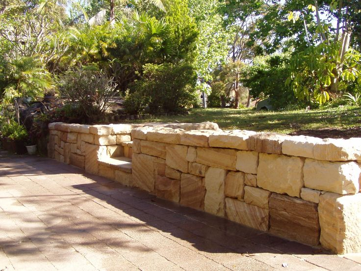 Sandstone wall http://www.lanninglandscapes.com.au/wp-content/uploads/2012/03/sandstone-wall-northern-beaches.jpg