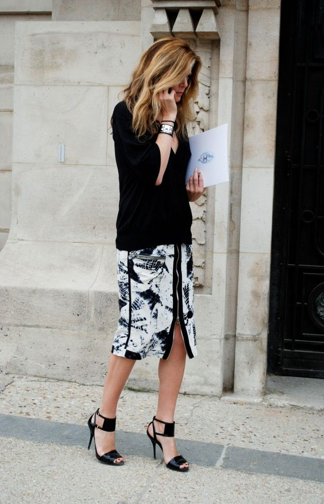 Printed skirt paired with a solid sweater.