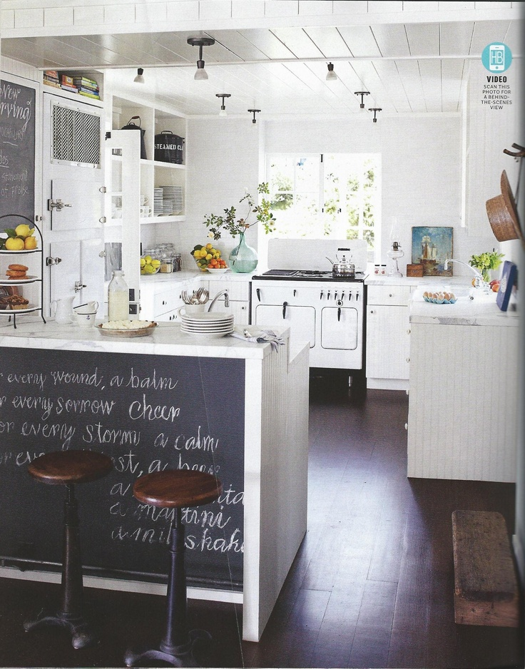 open cabinets, ceiling, and the peninsula placement