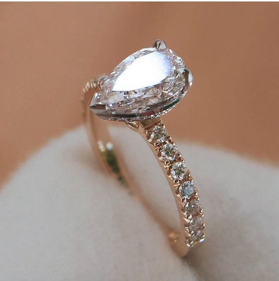 Naveya & Sloane bespoke pear shaped diamond centre stone, set in a platinum diamond set bezel. Crafted with an 18k rose gold claw set diamond band.