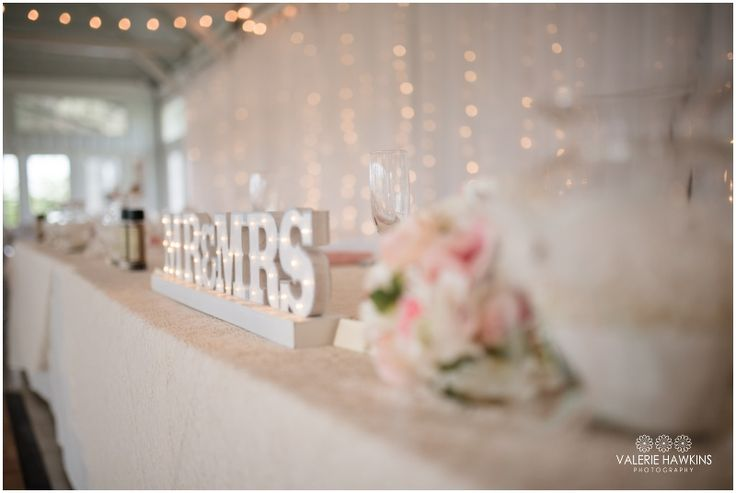 Lighted MR&MRS sign for head table with  Pink, Mint Green, Gray, Lace & Pearls, wine corks decor  Valerie Hawkins Photography: Magnolia Estate Wedding   Nate & Tiffany