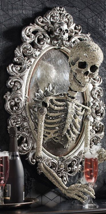 Think I might whip up something a little like this for the Front Door, using a dollar store frame, spray painted silver, and a plastic dollar store skeleton. Cute. Where is my glue gun? ~~ Houston Foodlovers Book Club