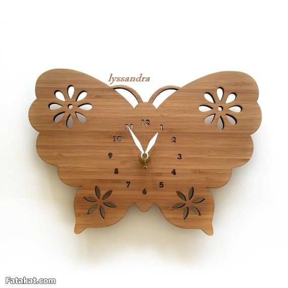 ساعة مصنعة من خشب الأبلكاج ( الأركت )