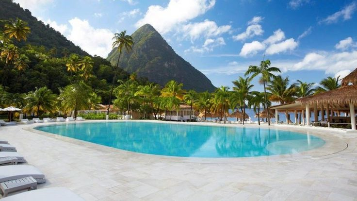 Sugar Beach St Lucia is superbly located in a bay between the majestic Pitons, on the magnificently tropical south west coast of the island. Luxurious, with the setting adding to the sense of romance and escapism. The international airport is 45 minutes' drive, the small town of Soufriere 10 minutes.