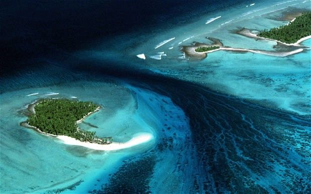 Kiribati is one of the lowest lying places on earth.  Just a few islands, and just a few feet above sea level.  They'll likely be the first unfortunate victims climate change; this article is about their attempts to buy land to migrate their entire nation before their islands disappear beneath the waves.