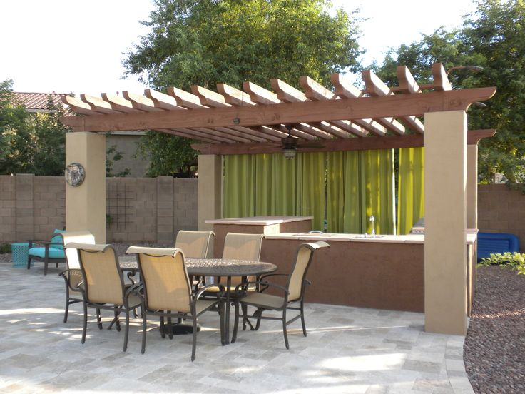 We built this Stained Wooden Gazebo with Stucco pillars for an outdoor barbeque area.
