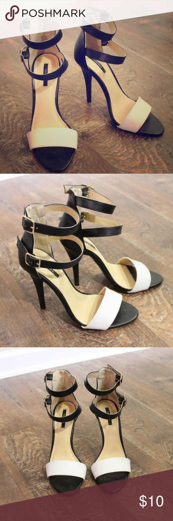 Black and White Strappy Heels Forever 21 Strappy Heels. Colors are black and white with gold buckles. Size not marked but I would say they're a 6.5. Only worn a few times! Forever 21 Shoes Heels