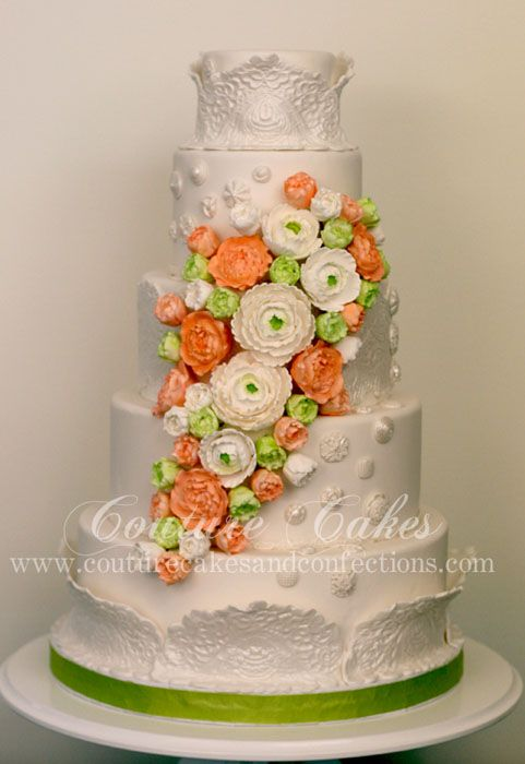 This cake has so many beautiful details from the lace work and sugar flowers! Couture Cakes can bring your cake vision to reality! Click the image to learn more. Photo credit: Couture Cakes webpage