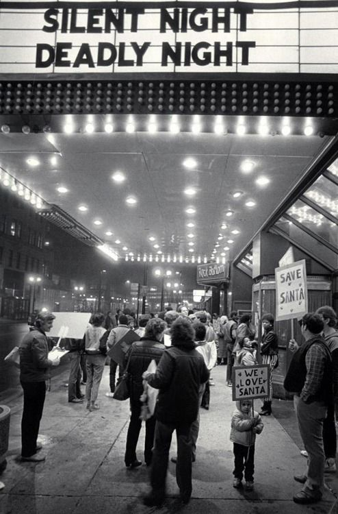 """Protesters picketing a showing of the horror movie """"Silent Night, Deadly Night"""" (1984)."""