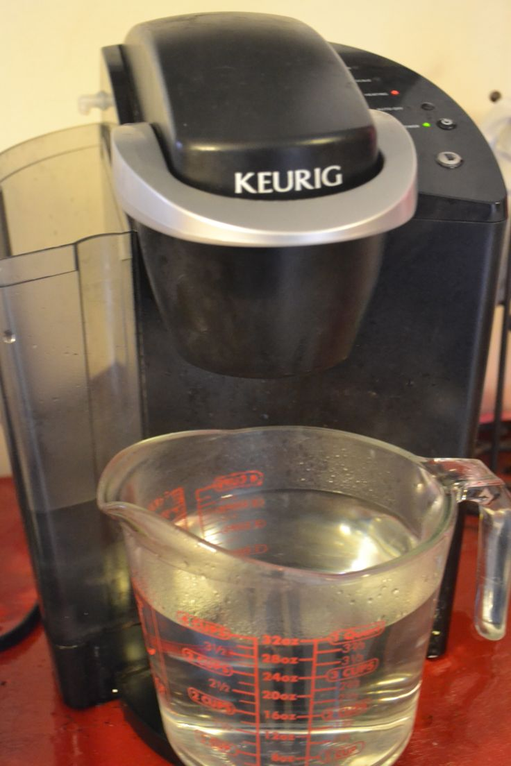 How to Clean Your Keurig.  Fill tank with vinegar, brew until it's gone.  Refill tank with water and brew until gone.  Repeat until water no longer smells like vinegar.