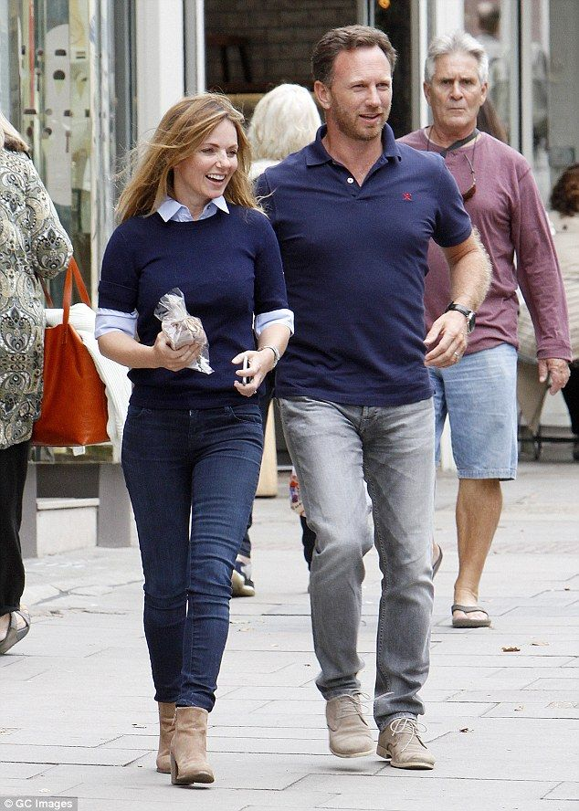 Newlyweds: Geri looked stunning in a crew-neck navy jumper, which she layered over a powde...