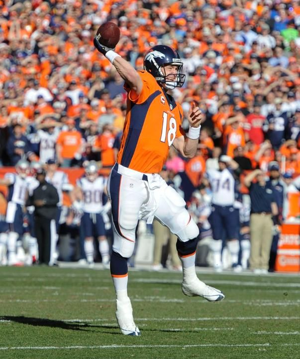 Peyton Manning in a very familiar pose - AFC Title Game: Broncos vs. Patriots (1/19/14)