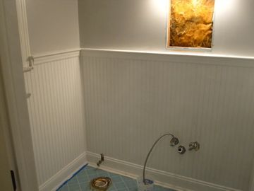 Ugly bathroom tile covered over with bead board; so much easier and did not have to remove th…