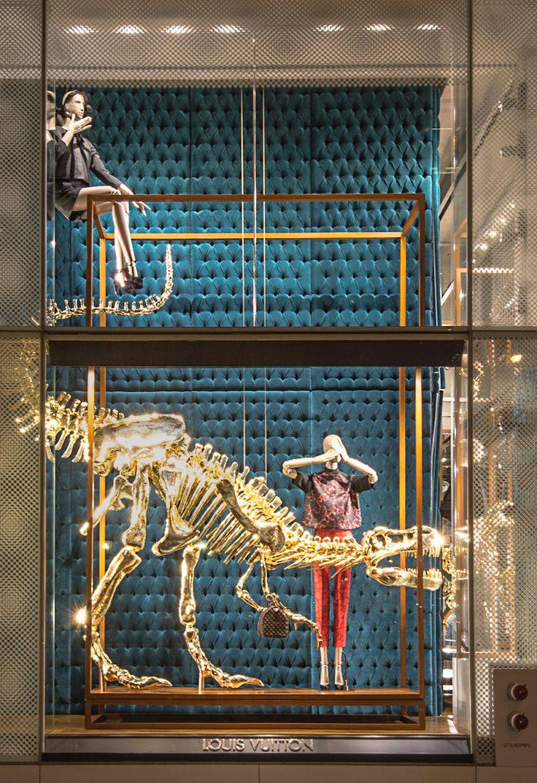 louis vuitton's gilded dinosaur bone window installation