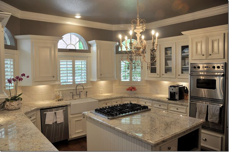 light colored granite (Bianco Romano), cream colored subway tile, farm-style sink, Stardust by Benjamin Moore paint, and white cabinets. Love the upgrade simplicity....dream kitchen!!!