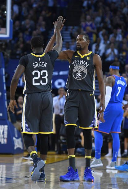 f9cab31f69d Kevin Durant of the Golden State Warriors is congratulated by Draymond  Green after Durant scored and was fouled on the shot against the Oklahoma  City.