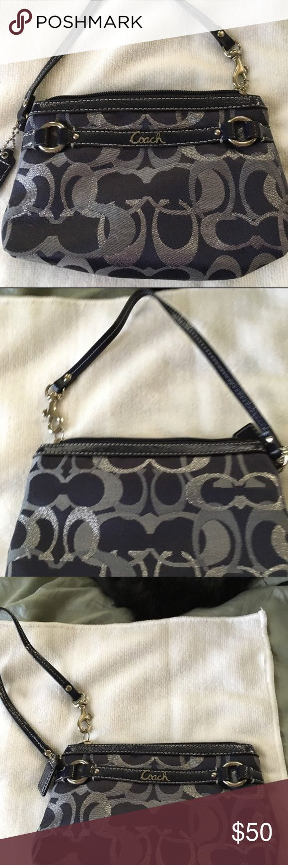 """NWOT Coach wristlet NWOT Coach wristlet. Navy blue with lighter blue and silver C's. Never used and in pristine condition inside and out. Measures approximately 7"""" x 5"""" Coach Bags Clutches & Wristlets"""