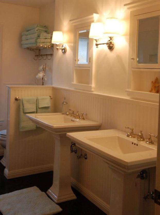 White on white bathroom with Kohler Memoirs pedastool sinks.