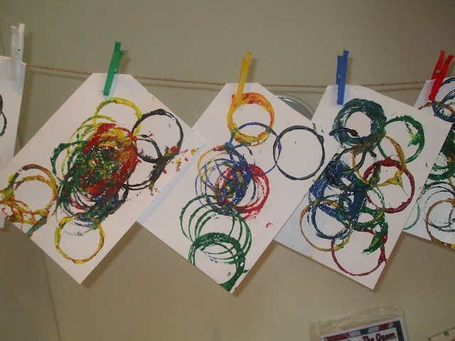 olympic circles made from large cardboard tube dipped in different colored paint.