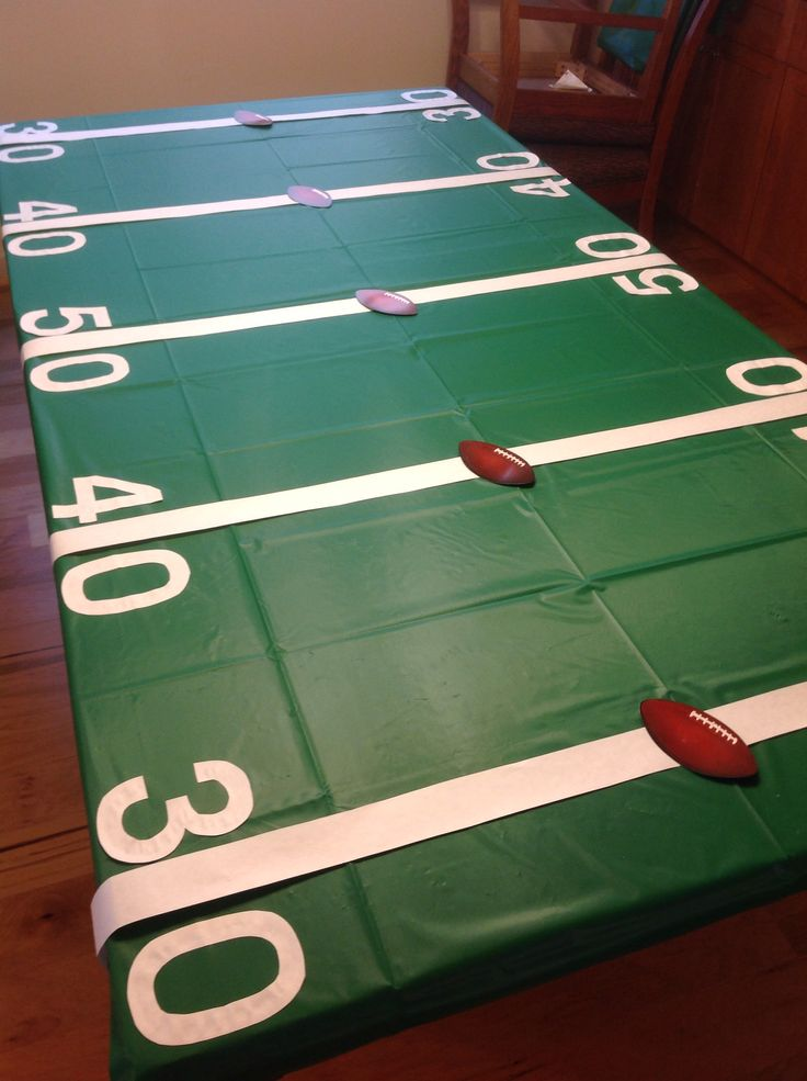 Plastic table cloth & white butcher paper for yard lines & numbers