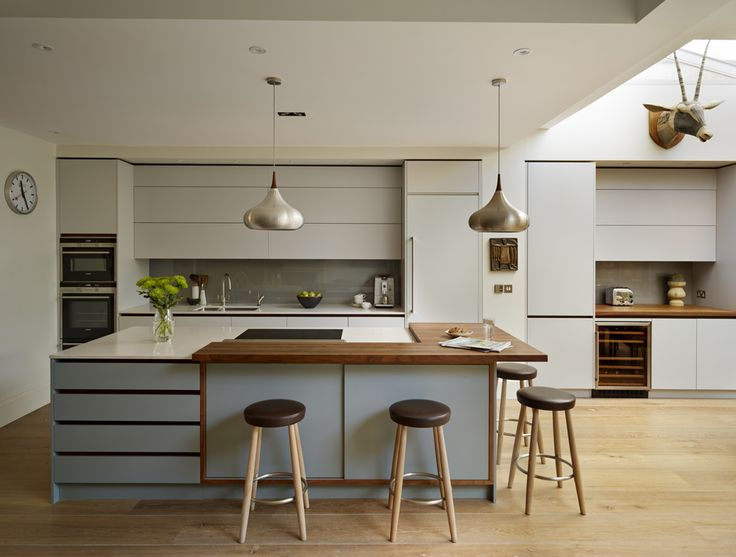 Roundhouse can match to practically any colour - here the cabinets are in Pearl Ashes 3 by Fired Earth and the island is in Graphite 4 by Fired Earth