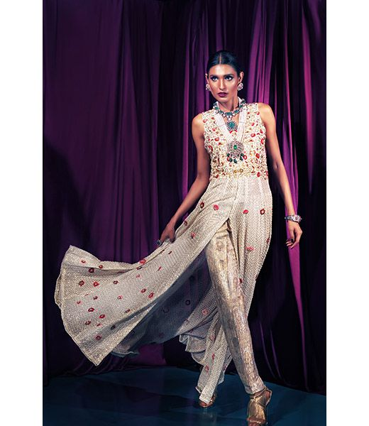 Maheen Karim is a ready to wear label pioneering women's western evening wear in Pakistan. Maheen has captured a niche market locally and internationally due to her innovative silhouettes and use of opulent fabrics. Specializing in luxury cocktail wear as well as pret-a-porter Maheen Karim is a brand synonymous with elegance and glamour.
