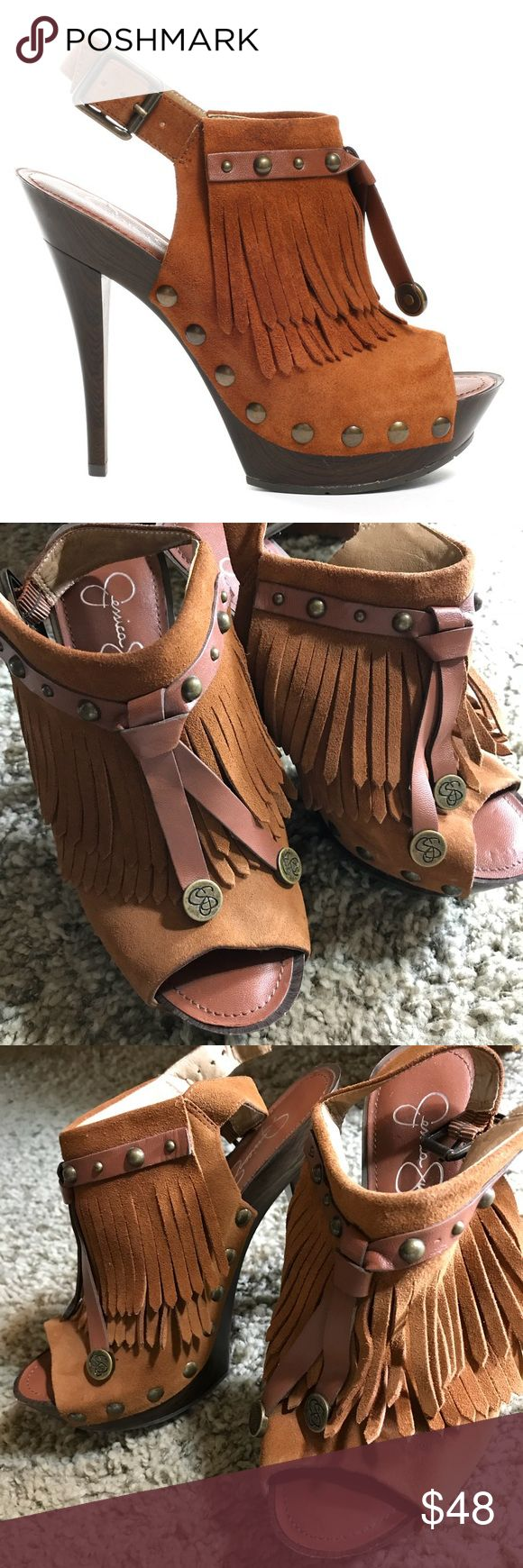 """Jessica Simpson peep toe leather fringed heels Brown Geni Heel suede leather, plastic woodgrain heel. Trendy style that goes with a variety of outfits, from jeans to long boho peasant skirts.  Pair has barely been worn. The inside of shoes is like new. On one shoe, the fringe is in disarray, as the shoe has been lying on its side in a closet, but it can be """"trained"""" back into shape once properly stored.  Some very minor scuffs. Plastic caps on heels show some wear, but the rubber sole looks…"""
