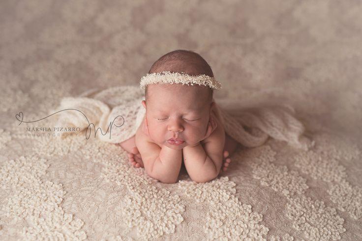 calgary newborn photography baby girl on cream lace fabric