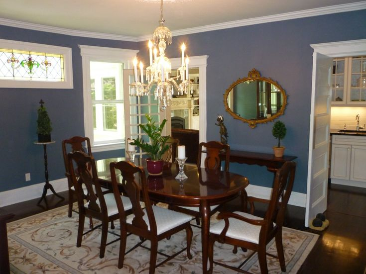 Dark Blue And White Wall Color For Dining Room Decorating With Traditional Ellipse Shaped Brown Wood Table On The Classic Beige Carpet Complete