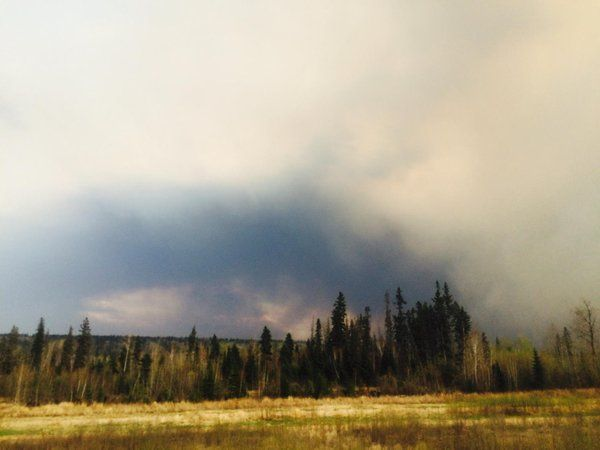 @warnicam  May 4 Heavy black smoke gathering east of Hwy 63 at the Parson's Creek exit #ymm #ymmfire