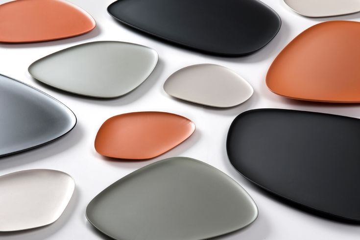 jean-marie massaud presented his first collection for kartell, the 'namaste' set of melamine dishes feature a soft, asymmetrical design suggestive of flat stones. conceived in a natural color palette: black, grey, beige and orange, the plates can be matched to create pleasant nuances or two-tone combos