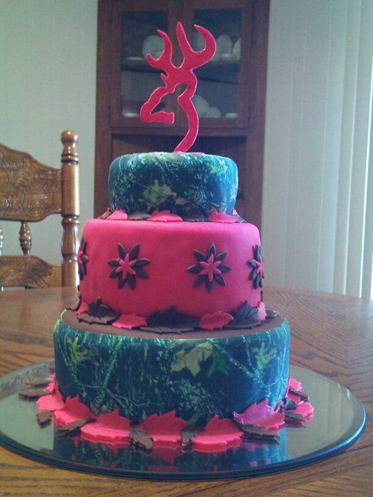 Camo Browning Country Girl's Pink Tiered Cake - This cake was for my niece's 12th birthday. It was Hot pink and chocolate swirled cake with buttercream under fondant overlay. The browning symbol is gumpaste. Thanks for looking!
