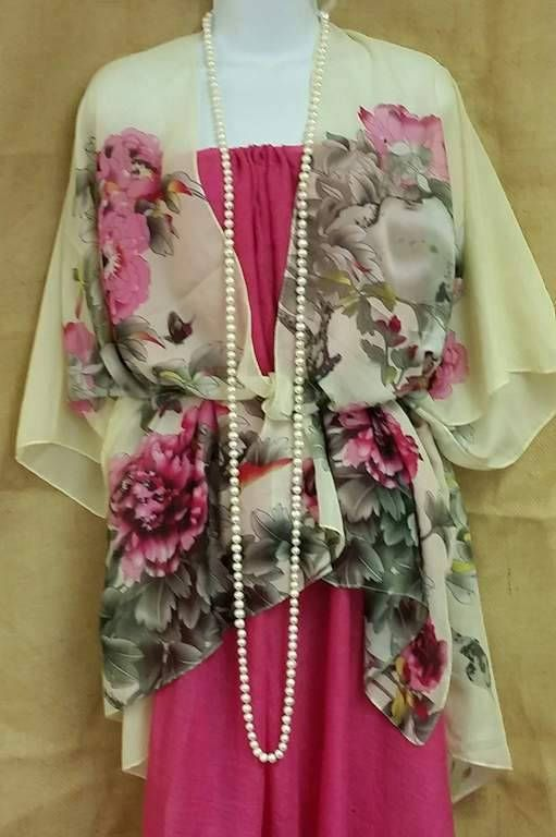 Gorgeous, lightweight, chiffon, plus size, kimono with stunning floral print. Perfect for the mother of the bride or groom. Dress up any outfit or wear it to the beach or pool as a swimsuit cover. How you wear it is up to you. Fits up to 3x.