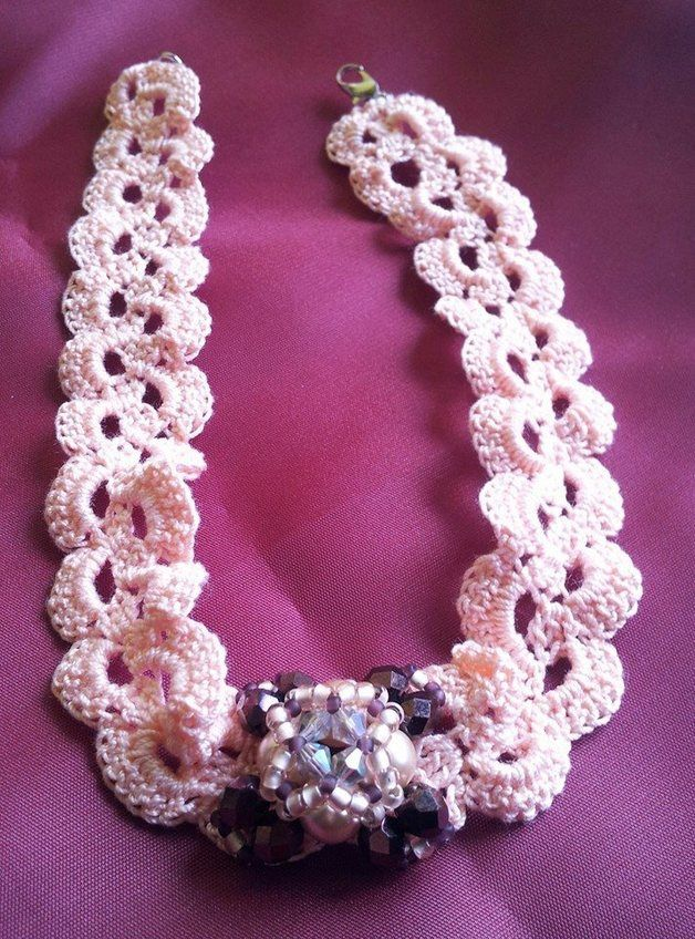 Crocheted pink chocker with beaded element
